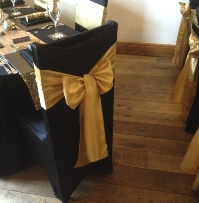 Gold Taffeta Chair Sash on black chair cover| Wedding | Carlisle | Cumbria | Lake District | Gretna | Newcastle | The Plough at Wreay