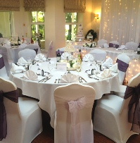 Plum and Lilac Organza Chair Sashes with white chair cover | Wedding | Carlisle | Cumbria | Lake District | Gretna | Newcastle | Hunday Manor Hotel