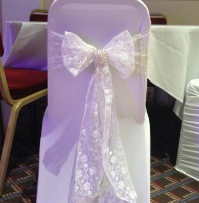 Ivory Lace with white ruched chair coverss | Wedding | Carlisle | Cumbria | Lake District | Gretna | Newcastle | Crown & Mitre