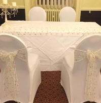 English Rose Garden Embroidered Chair Sash White Chair Covers | Wedding | Carlisle | Cumbria | Lake District | Gretna | Newcastle | Hallmark Hotel