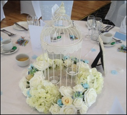 Ivory Tall 4-tealight Holder Bird Cage with Ivory & Blue Floral Arrangment to hire | Wedding | Events | Carlisle | CuFambria | Creighton Rugby Club | Rustic Hessian Wedding