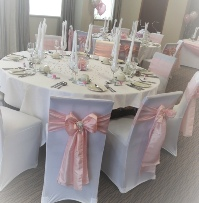 Pale Pink Taffeta with large diamante embellishment White Chair Covers | Wedding | Carlisle | Cumbria | Lake District | Gretna | Newcastle | Greens Hotel
